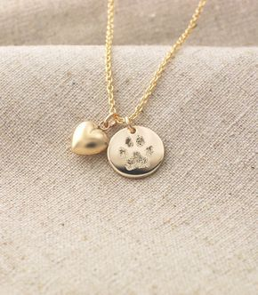 Your pet's actual paw print custom personalized pendant and puffed heart charm necklace in 14k yellow gold fill • Pet memorial jewelry by CherishedSentiments on Etsy https://www.etsy.com/listing/220822961/your-pets-actual-paw-print-custom