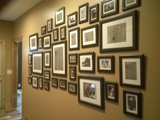 Entry Wall Gallery - $149 worth of IKEA Virserum matted black frames.  Easels removed from backs.  Putty in lower corners of framed photos to keep frames straight.  Worth every dollar and hour I spent.  Love this hallway.