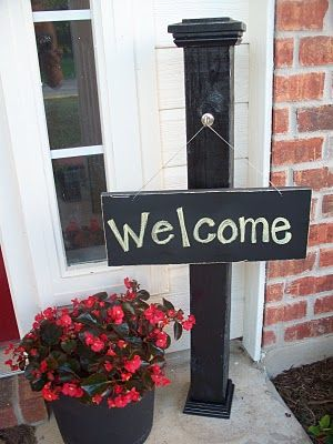 Front porch sign post.  It needs a larger base to keep it from blowing over.  Black paint looks nice.  A decorative drawer knob would be great.   I would put this on the right side of the front doors, so it can't interfere with the house numbers.