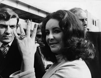 Elizabeth Taylor wears the 33.19 carat Elizabeth Taylor Diamond, a gift from Richard Burton, which sold for $8.8 million at Christie's in 2011. Photo by Getty Images.