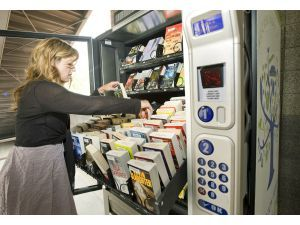 """""""Andrea Taylor, Technical Services Division Manager with the Fullerton Public Library, stocks books into the library's new book vending machine located at the SOCO West Parking Structure near the Fullerton Train Station Tuesday. It is believed to be the first of its kind in the county. The machine will have the capacity to dispense 500-books."""" Nice story about the grant and the machine at the click-through.: Libraries, Train Station, Vending Machines, Article, Book Vending, Dispense 500 Books, Favorite Books, Junk Bookshop, Library Vending"""