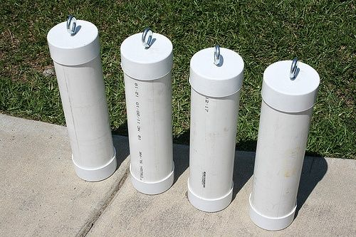 Tent or awning weights...used PVC pipe and caps and an eye bolt with a washer...filled with cement, I'd paint them turquoise :) - ruggedthug