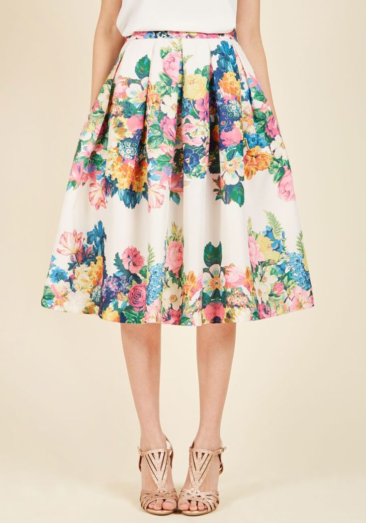 Bouquet of Beauty A-Line Skirt in Eggshell | Mod Retro Vintage Skirts | ModCloth.com  Ensure sartorial success by adding this ivory skirt's plethora of panache to your look! Prettily pleated and covered in a rainbow of florals, this mid-length bottom bestows harmonious elegance upon any outfit. Don't you just love it when an ensemble comes together perfectly? Us, too!