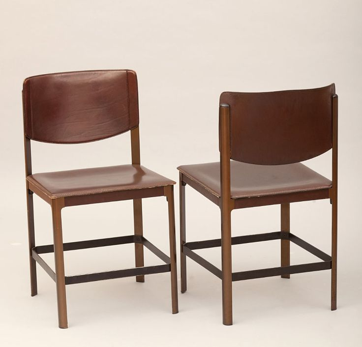 "SET OF 2 ""KORIUM"" CHAIRS  This rare model features a structurally excellent steel frame and handsomely aged leather that adds an air of distinction to this vintage chair.  Leather back marked with ""Matteo Grassi"" stamp."