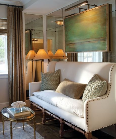 belgian linen & down filled sofa against a mirrored wall with abstract art - love the high back, nailheads, light wood legs - please come home with me?
