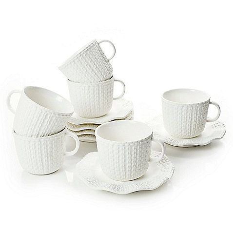 Designed to dress up your tea in sweet style, the Classic Coffee & Tea Sweater Teacups and Saucers make a charming addition to your table. These transitional-style porcelain pieces are exquisitely detailed with a stitch-inspired texture.