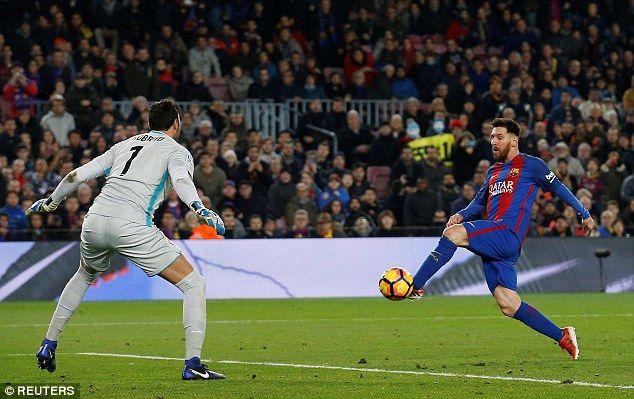Messi (right) scores his team's fourth goal through the legs of Roberto Jiminez (left)