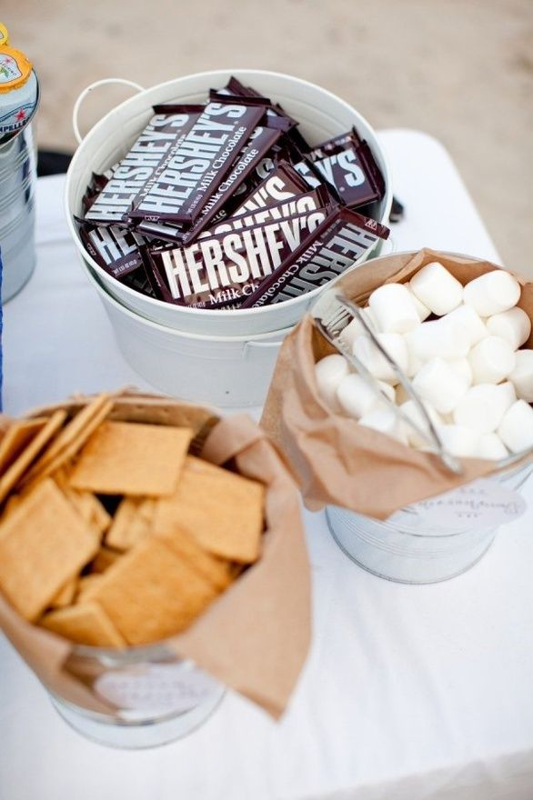 Smores at the Fire Pit , outdoor wedding!! Surrounded with hay bale seating comfy cozy!
