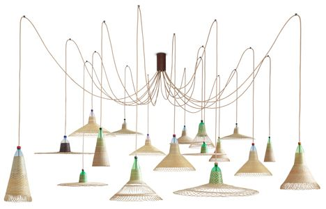 Alvaro Catalan de Ocon's PET Lamps project has created a range of wicker lamp shades woven with old plastic bottles by artisans in Chile.