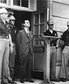 Wallace in the Schoolhouse Door - Marking the 40th Anniversary of Alabama's Civil Rights Standoff | NPR :: Forty years ago, Alabama Gov. George Wallace stood at the door at the University of Alabama in a symbolic attempt to block two black students from enrolling at the school. NPR's Debbie Elliott reports how the drama of the nation's division over desegregation came sharply into focus that June day.