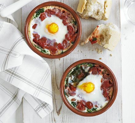 Baked eggs with spinach & tomato. A rustic dish with a delicious combination of flavours and just four ingredients, try whipping it up for brunch.
