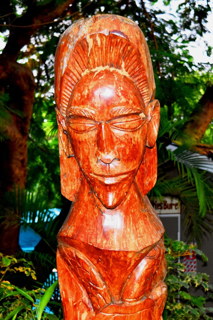 Large statue carving near the pool.