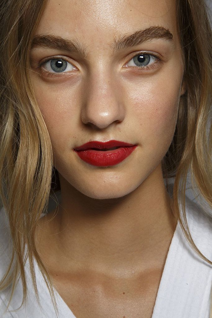 Matte red lip and bold brows at Burberry Prorsum Spring 2015