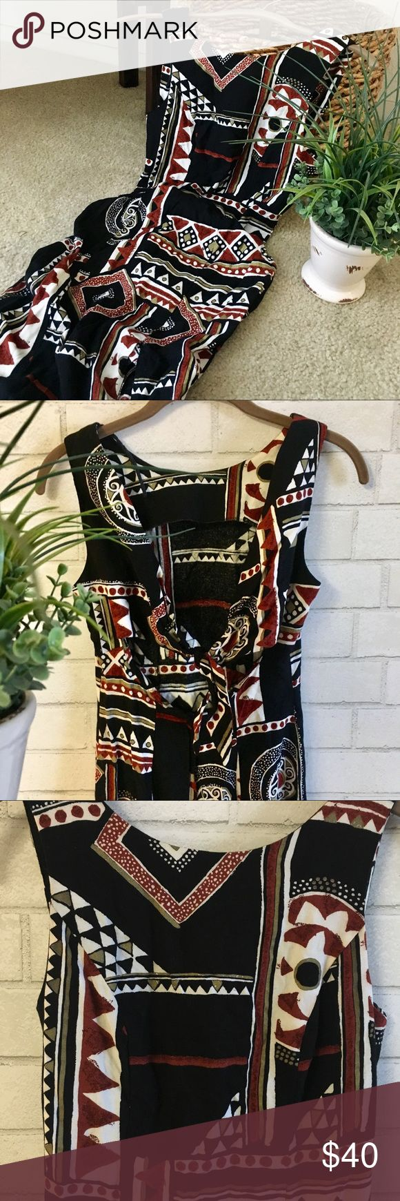 🌵🌺Beautiful Vintage Tribal Maxi Dress🌺🌵 🌵🌺Beautiful Vintage Tribal Maxi Dress🌺🌵 This is absolutely Stunning on and perfect for the Summer! It's true Vintage size 7/8 but fits like a Small. It's 100% Rayon, Dry Clean Only. Has a pretty Tribal Black, Rust, White Print, slit on one side, a low back with a zipper and cute bow for added fun! Won't last long! It's never too early to get ready for Summer! Great Condition. Comes from a smoke free home:)🌺 New Listing✨☀️ Dawn Joy Fashions…