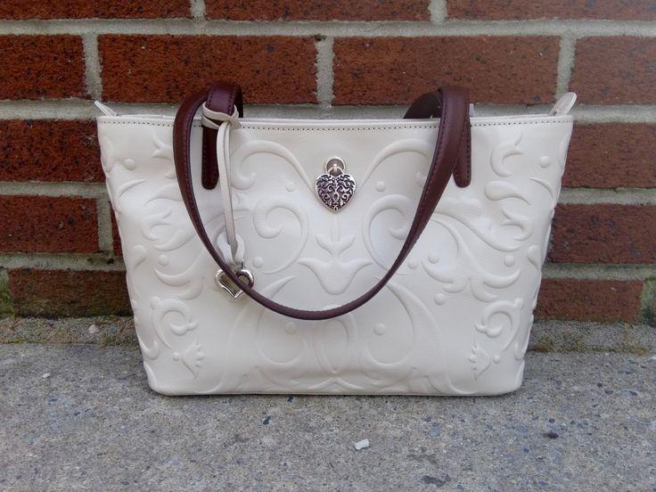 Creamy swirls, dark straps, and an accent of jewelry make for one beautiful Brighton purse!