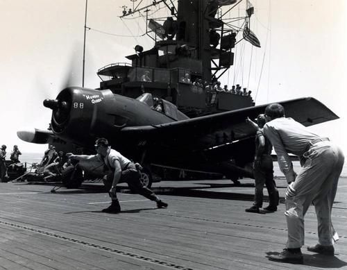 """USS Block Island CVE 106 - F6F-5N Night Hellcat May 1945 USS Block Island (CVE 106). A Grumman F6F-5N """"Night Hellcat"""" prepares for a catapult launch during operations in the Nansei Shoto region, circa May 1945. The plane is dubbed """"Hanger Queen""""."""