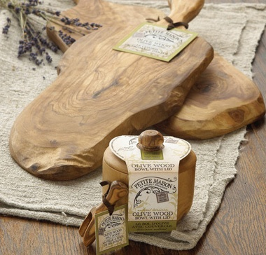 Rustic Olivewood Cutting Board & bowls by Wildly Delicious. No two are alike;  brings the aura of a country kitchen to your home. Handcrafted in a small town in Germany these limited edition series of truly unique, meticulously prepared items are available while quantities last. www.lambertpaint.com