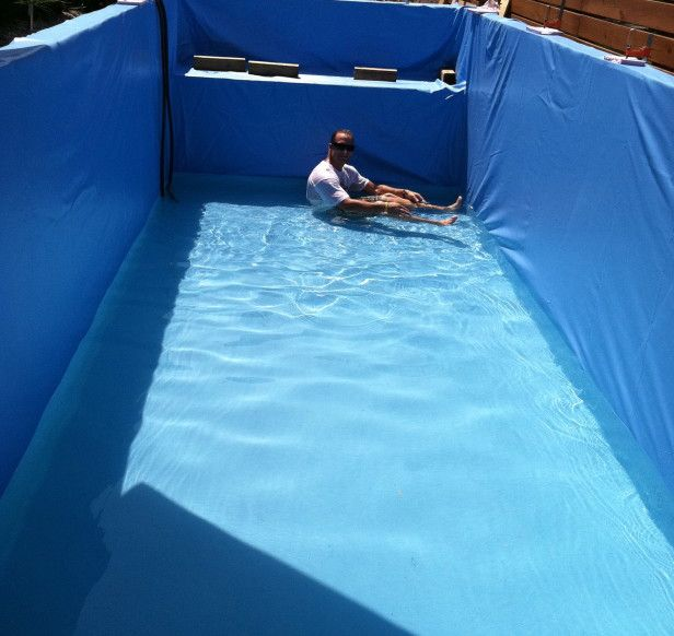 At this stage, the dumpster is lined with a half-inch of high-density foam for insulation and padding for the feet. This is followed by the installation of a custom-fit, flexible pool liner which is found in most above-ground pools. It is important to massage out the wrinkles while the pool fills with water.