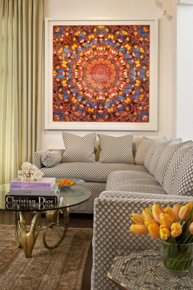 Vibrant Orange And Blue Butterfly Wall Art In A Neutral Living Room