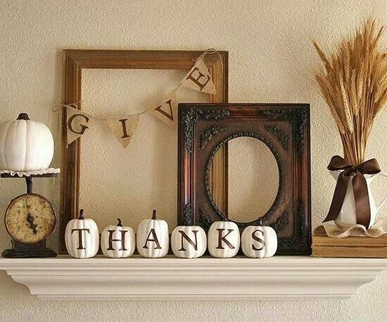 Thanksgiving shelf decor. Great way to use those little white pumpkins!