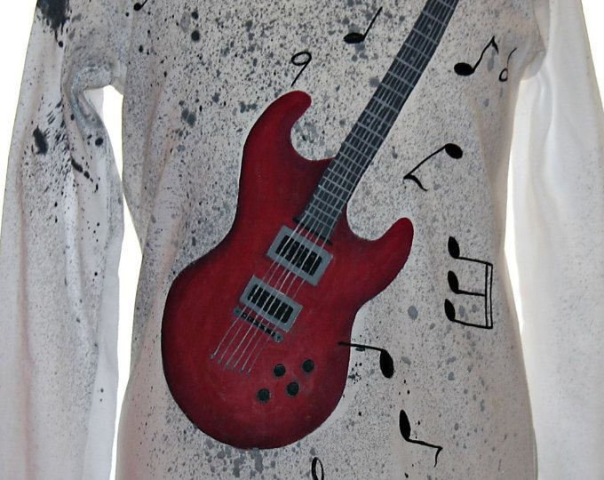 Hand painted boy's t shirt. I use non-toxic, water based, permanent fabric colors. | It's a red electric guitar on a dark gray splatter background.