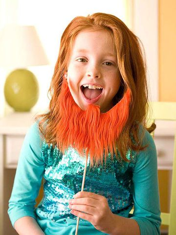 Warning: This easy-to-make prop may give your child mischievous ideas. Print out our beard template below. Cut the shape from a piece of faux fur and a piece of corrugated cardboard (with the corrugations running vertically). Glue the fur to the cardboard. Place a bit of glue on the end of a bamboo skewer, then insert it into one of the center flutes of the cardboard. Let the glue dry before employing the disguise.                 Originally published in the March 2013 issue of FamilyFun…