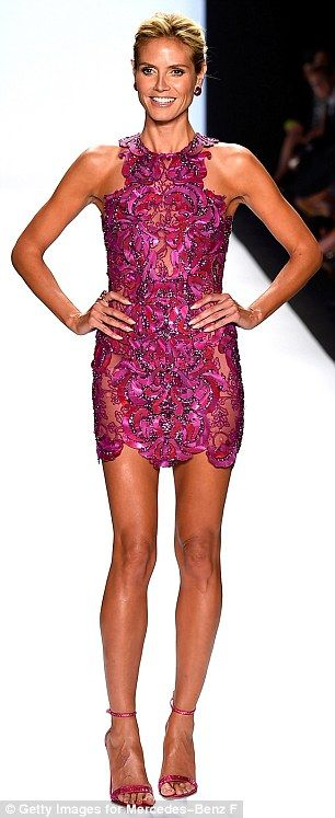 Heidi Klum legged it down the runway in a dazzling pink mini-dress and matching jewel-encrusted fuchsia stilettos at the #NYFW Project Runway fashion show http://dailym.ai/1vXSffF