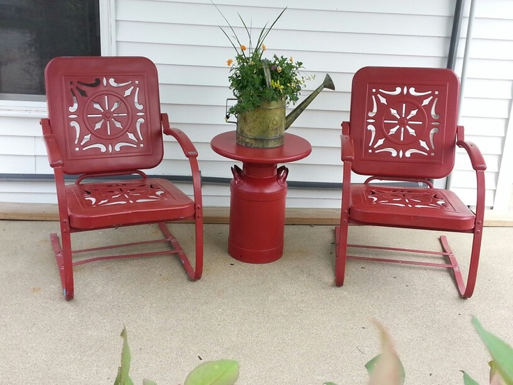 My milk can patio table that I made to go with my antique metal chairs. Created by Nancy Carter.