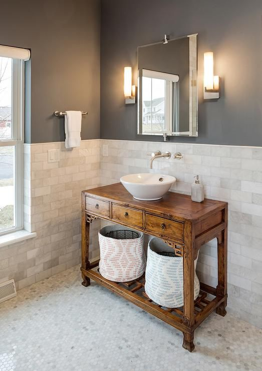 Stunning bathroom features charcoal gray paint on upper walls, Jeff Lewis Color Carbon, and marble ...