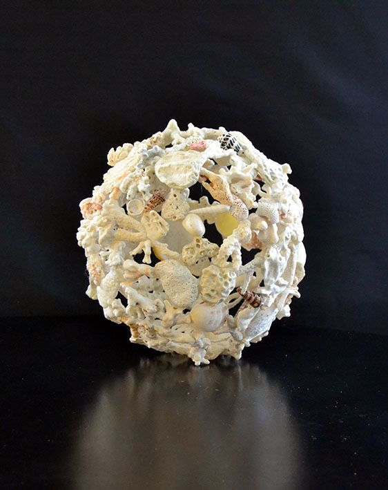 A Coral and Seashell Globe By Nedo Delport.