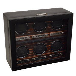 """Wolf Designs 459256 Roadster Module 2.7 Roadster Six Cover Ebony Watch Winder Wolf Designs. $1899.00. Lock-in cuff designed to fit larger, heavier watches. Clicks and """"locks"""" into the turning drum for a secure hold.. Program start delay options from 6 hours to 72 hours.. Individual options of rotation and direction settings combine to offer 57 personal programming options. Rotation settings from 300-1200 turns per day and directional setting options of clockwise, counter-cl..."""