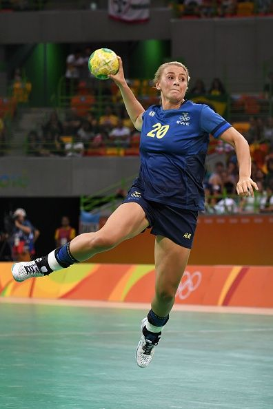 #RIO2016 Best of Day 1 - Sweden's centre back Isabelle Gullden jumps to shoot during the women's preliminaries Group B handball match Sweden vs Argentina for the Rio 2016...