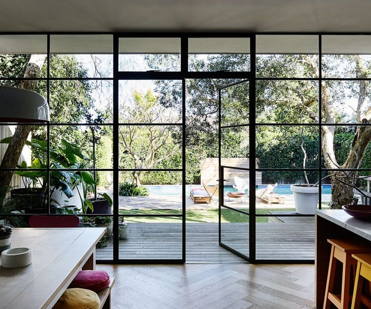 "The wall of black-steel-framed windows and doors is something Rachel was very particular about. ""The doors were custom-made in Melbourne, brought up on a truck and installed over a few days. Two things I refused to compromise on were the windows and floors, and these are the two things I'm happiest with,"" Rachel says."