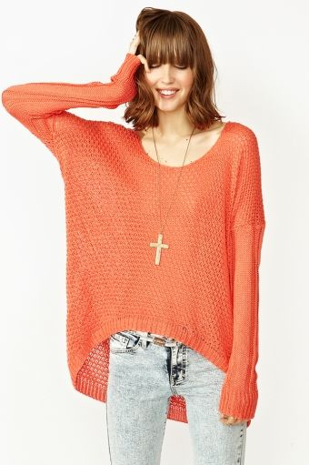 Super cute coral knit featuring a loose weave and deep scoop neckline. Ribbed hem, cut longer at back. Oversized fit. Perfect paired with skinnies and a backpack!