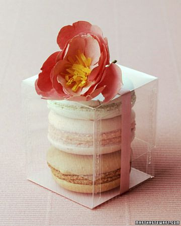 Show off macaroon favors in a see-through container and adorn it with a paper flower.