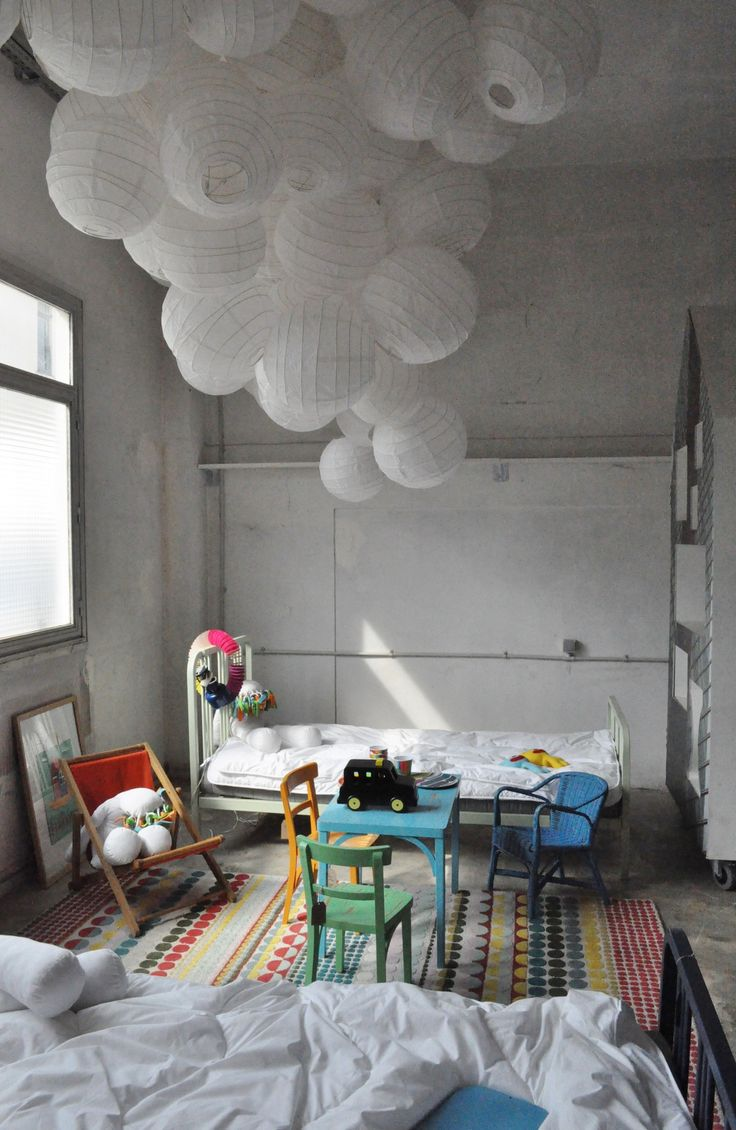 lovely kids room I love the big jumble of paper lanterns on the ceiling