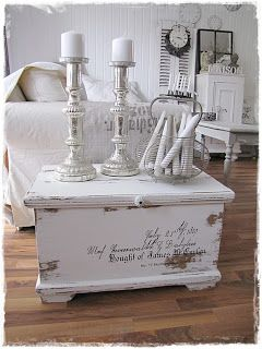 Distressed, painted blanket chest featuring a quote