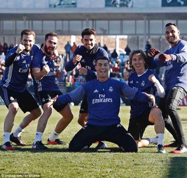 Cristiano Ronaldo and his Real Madrid team-mates pose in front of the crowd at the session