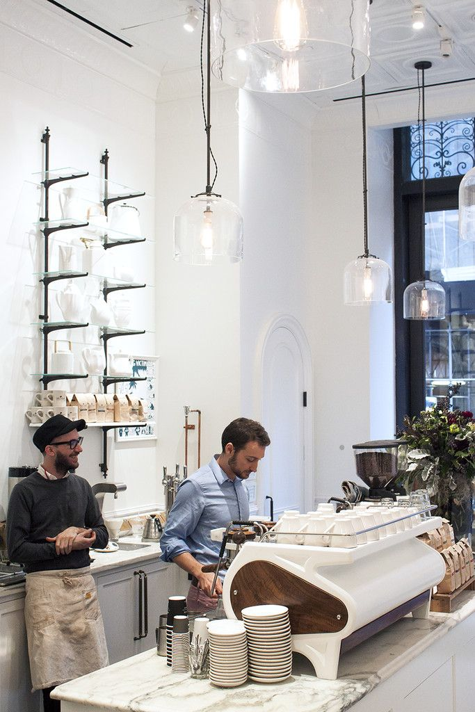 I love how this industrial inspired space does not shy away from using an all white interior to make a statement.  Toby's Estate Coffee | Manhattan, NYC