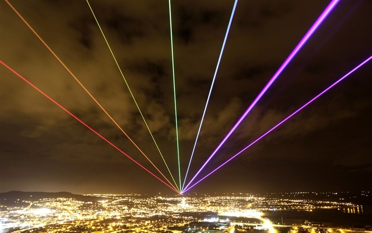 Peter Morrison / AP    The Global Rainbow is projected into the night sky from Scrabo Tower, in Newtownards, Northern Ireland on March 16.