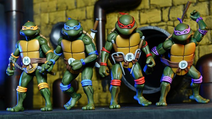 For as long as there have been Teenage Mutant Ninja Turtles toys, Playmates has been the company that holds the master toy license. But at every step, NECA has tried to find loopholes in the deal that would allow them a way in as well. For a while, when Playmates was only doing toys from the cartoon, NECA did comic-based figures...but then Playmates regained that part of the license. Recently, NECA has been doing 18-inch versions of the original 1991 movie turtles, as Playmates' license d...