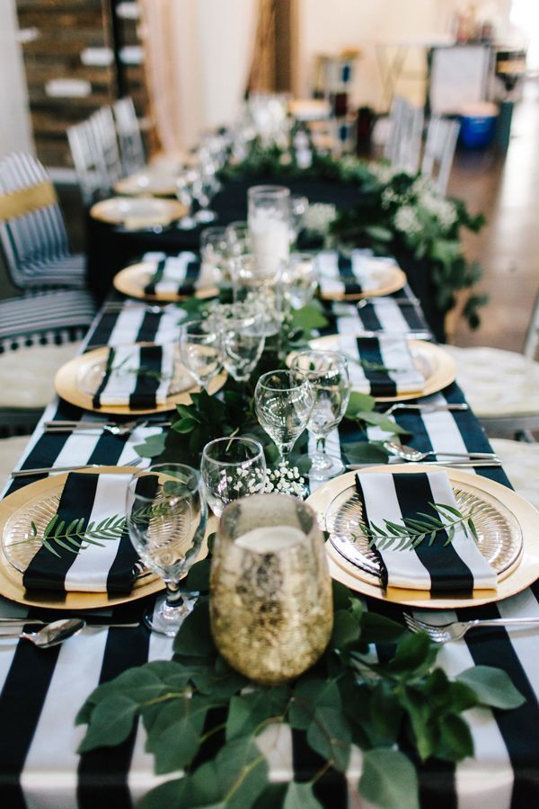 striped reception tablecloth - photo by Sarah Libby Photography http://ruffledblog.com/modern-black-and-white-wedding-with-emerald