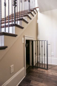 Dog kennel under the stairs, dog cage under the stairs | Rustic Lake Home | Durham Designs & Consulting, LLC | www.designsbydurham.com | Photograph by Livengood Photographs [www.livengoodphotographs.com]