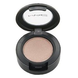MAC's Naked Lunch. I use this eyeshadow EVERY DAY. it's the first color I put on, and I always build all my other colors around it. it's natural and skin tone and the perfect shadow to sweep on when you're running late and don't have time to do much with your face. I love it. $15