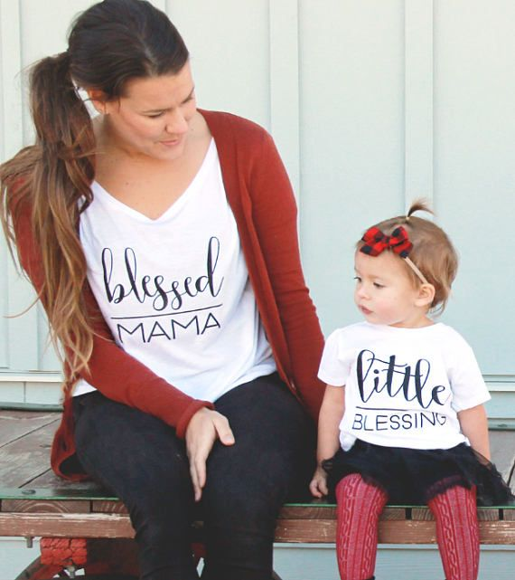This Blessed Mama/Little Blessing Mommy and Me set can be worn by girls and boys alike. Mommy and me matching is so much fun - get in on the action with this super simple and classic shirt set! This also makes a great baby shower gift for an expecting mom or something sweet to bring a new mom when you meet baby for the first time!  Choose between solid black design or, our favorite, black GLITTER! If you would like to customize the design color just specify your color choice (one color)...