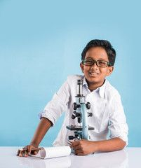 indian boy and microscope, asian boy with microscope, Cute little kid holding microscope, 10 year old indian boy and science experiment, boy doing science experiments