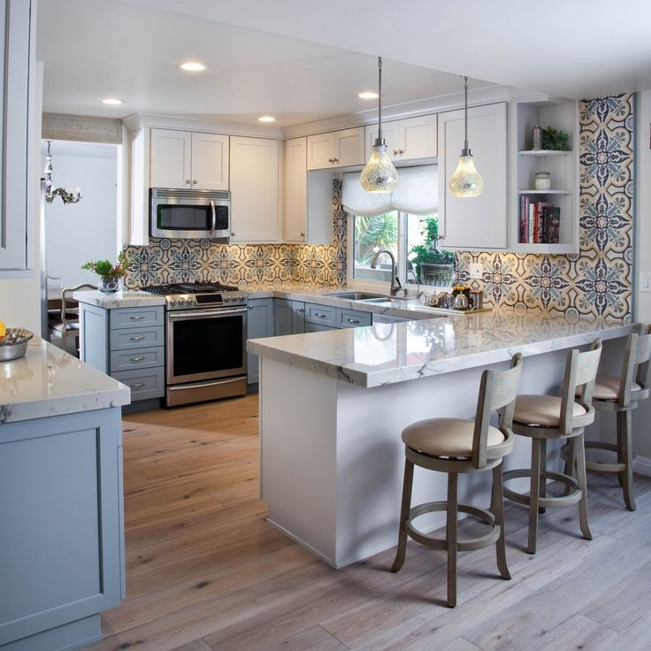 Colorful Kitchen design with blues, grays and white featuring 2-tone gray and white cabinets with Dura Supreme Cabinetry.