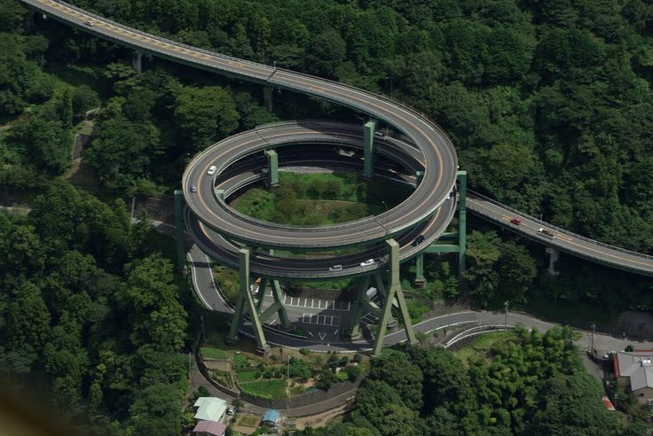 Kawazu Nanadaru Loop Bridge, Japan, 1982. The bridge on Highway 414 between Tokyo and the Izu peninsular is a well known landmark, sometimes known as the Japanese Double loop spiral. This unique structure looks more like a roller coaster than a motorway and brings cars up and down a full 45 meters (148 feet) in a valley between two mountainsides. Some other stats: 1.1 kilometers long, the diameter is 80 meters, speed limit 30 km/h.