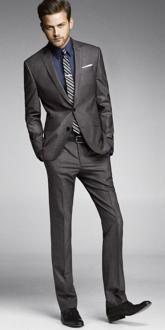 Charcoal grey tailored suit - this should be the first suit in your wardrobe. Can be worn to work or weddings (if you don't have a black suit already). #staples #mensstaples #mensfashion #menssuitsblack