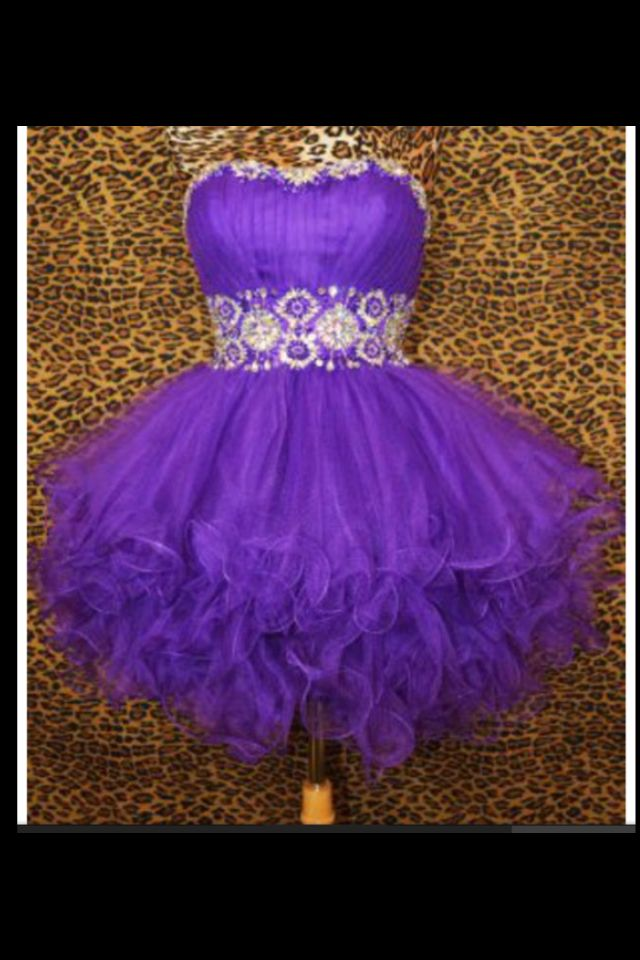 Purple dress with studded middle section short and poofy bottom.